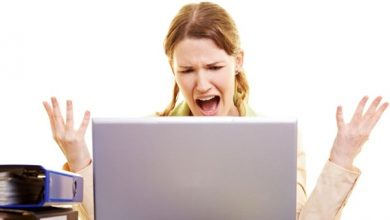 Woman screaming at her laptop