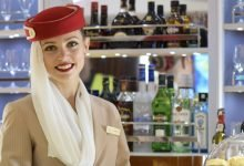 Emirates_flight_attendant_in_the_Airbus_A380_bar-1024x471