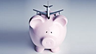 Piggy bank with airplane balanced on top