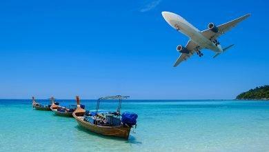 airplane over tropical seas